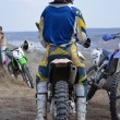 Motocross rider in the helmet is sitting on a motorcycle — Stock Photo