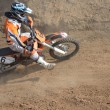 Motocross rider on the motorcycle accelerates from turning — Stock Photo