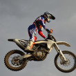 The spectacular jump motocross racer on a motorcycle — Stock Photo