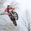 A jump rider on a motorcycle motocross — Stock Photo