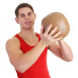 Guy with a medicene ball — Stock Photo