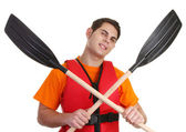 A guy with crossed oars — Stock Photo