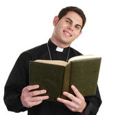 Priest with bible — Stock Photo