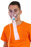 A young guy wearing an oxygen mask — Stock Photo