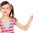 Smiley little girl pointing at something — Stock Photo #6832142