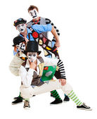 Four mimes over white background — Stockfoto