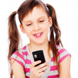 Smiley little girl with cellphone — Stock Photo