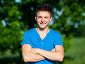 Cheerful young man in blue t-shirt — Stock Photo