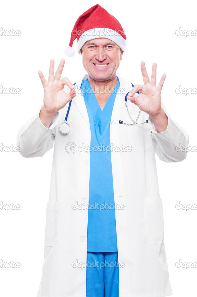 Smiley doctor in red santa hat showing ok sign. isolated on white background  — Stock Photo #7392288