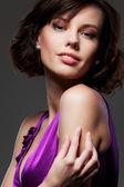 Alluring woman over dark background — Stock Photo