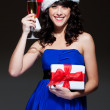 Attractive santa girl with glass and gift — Stock Photo #7627191