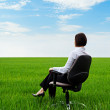 Businesswoman sitting on chair — Stock Photo #7627199