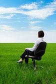 Businesswoman sitting on chair — Stock Photo