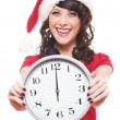 Laughing girl with santa hat holding clock — Foto Stock