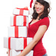 Santa girl holding many boxes — Stock Photo