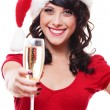 Woman in santa hat holding glass of champagne — Stockfoto