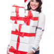 Woman in santa hat holding gift boxes — Stock Photo #7673081