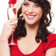 Woman in santa hat holding glass of champagne — Foto de Stock
