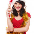 Woman with gold tinsel holding glass of champagne — Stok fotoğraf