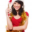 Woman with gold tinsel holding glass of champagne — Stock Photo