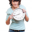 Young woman pointing at clock — Stock Photo