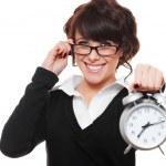 Businesswoman holding alarm clock — Stock Photo