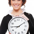 Smiley businesswoman holding clock - Stok fotoğraf