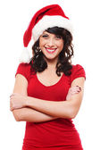Cheerful young woman in red santa's hat — Stock Photo