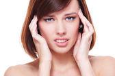 Sad young woman have a headache — Stock Photo