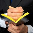 Businessman holds his notebook — Stock Photo