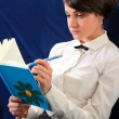 Woman with notebook. close up — Stock Photo #6975344