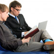 Two students with notebook and laptop. — Stock Photo