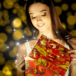 Girl opens gift — Stock Photo #7604545