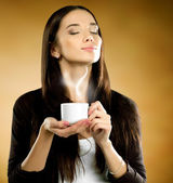 Woman with coffee cup — Stock Photo