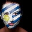 Portrait of a woman with the flag of the Uruguay — Stock Photo