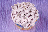Fancy light purple cupcake — Stock Photo