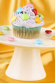 Cupcake with colorful sugar-coated hearts — Stock Photo
