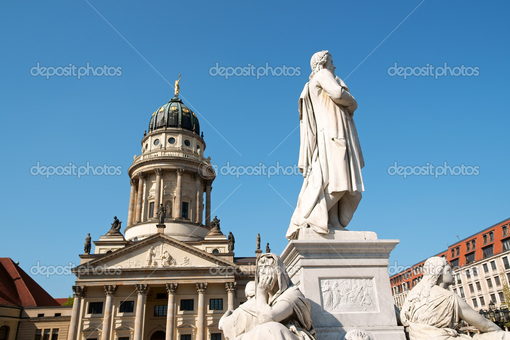 Detail of the French Dome and the monument to german poet Friedrich Schiller in Gendarmenmarkt Square in Berlin. — Stock Photo #6876697