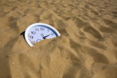 Watch in the sand — Stock Photo