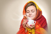 Hot drink from a cup. — Stock Photo