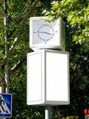 Blank billboard with clock — Stock Photo
