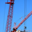 Crane Booms Construction Site - Stock Photo