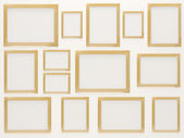 Empty Golden Photo Frames — Stock Photo