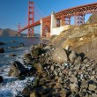 Foto Stock: Golden Gate Bridge in SFrancisco during sunset with r