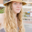 Portrait of blond girl  in hat. — Stock Photo