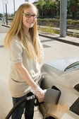 Woman refuel her car. — Stock Photo