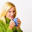 Beautiful young woman with tea cup — Stock Photo