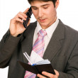 Young businessman with phone and diary — Stock Photo
