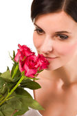Beautiful women with red roses — Stock Photo