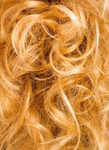 Blonde curly hair - background — Stock Photo